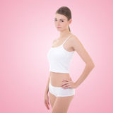 Young woman in cotton underwear over pink Stock Photos