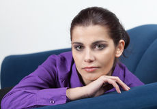 Young woman on a couch Stock Photo