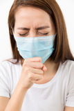 Young woman cough with protective face mask. Isolated on white background Stock Image