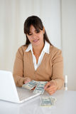 Young woman counting cash money for buying Stock Photo