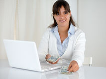 Young woman counting cash money for buying Stock Photos