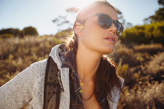 Young woman on country hike Royalty Free Stock Photography