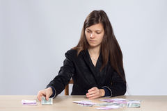 Young woman counts money Stock Photography