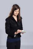 Young woman counts money Royalty Free Stock Photography