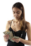 Young woman counts money for savings Stock Images