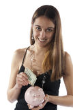 Young woman counts money for savings Royalty Free Stock Images