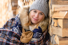 Young woman cover in blanket posing winter Royalty Free Stock Image
