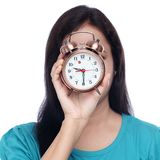 Young woman covered her face with alarm clock Stock Image