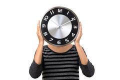 Young woman covered her face with clock Royalty Free Stock Photo