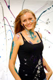 Young woman covered in paint Royalty Free Stock Photo
