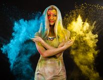 Young woman covered with paints Royalty Free Stock Image