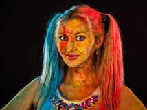 Young woman covered with paints Stock Photography