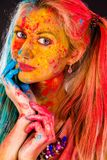 Young woman covered with paints Royalty Free Stock Photo