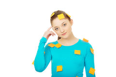 Young woman covered with post it notes. Stock Photo