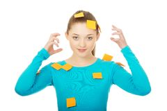 Young woman covered with post it notes. Royalty Free Stock Images