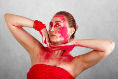 Young woman covered with red paints Stock Photos
