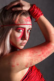 Young woman covered with red paints Royalty Free Stock Photos