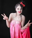 Young woman covered with a white powder showing victory signs Royalty Free Stock Photos