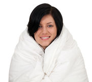 Young woman covering in duvet Stock Photos