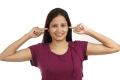 Young woman  covering ears Royalty Free Stock Photos