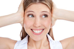 Young Woman Covering Ears Stock Image