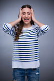 Young woman covering ears Royalty Free Stock Photo