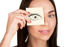 Woman covering eye with sticker Royalty Free Stock Image