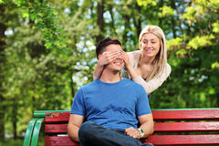 Young woman covering the eyes of her boyfriend Royalty Free Stock Image