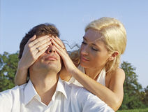 Young woman covering eyes of m Royalty Free Stock Photos