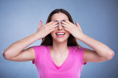 Young woman covering eyes Royalty Free Stock Images