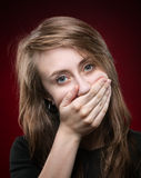 Young woman covering the face with her hand Stock Photography