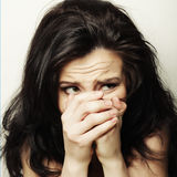 Young woman covering the face with her hand Royalty Free Stock Images