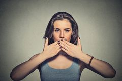 Young woman covering with hands her mouth Royalty Free Stock Images