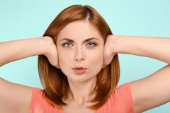 Young woman covering her ears Royalty Free Stock Photography