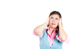 Young woman covering her ears looking up, as if to say, stop making that loud noise it's giving me a headache Stock Image