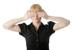 Young woman covering her eyes royalty free stock photos
