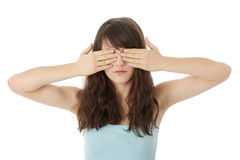 Young woman covering her eyes Stock Images