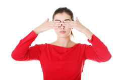 Young woman covering her eyes Stock Photos