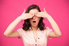 Young woman covering her eyes with hands Stock Photography