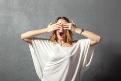 Young woman covering her eyes with hands Royalty Free Stock Photos