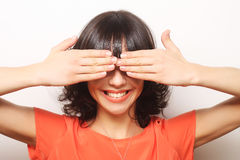Young woman covering her eyes with her hands. Royalty Free Stock Images