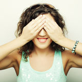 Young woman covering her eyes with her hands. Stock Photography