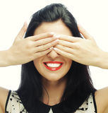 Young woman covering her eyes with her hands. Royalty Free Stock Photos