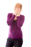 Young woman covering her face with her hands Royalty Free Stock Photography