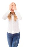 Young woman covering her face with her hands Stock Image