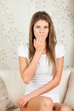 Young woman covering her mouth Royalty Free Stock Photo