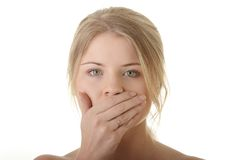 Young woman covering her mouth Royalty Free Stock Images