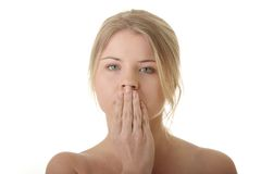 Young woman covering her mouth Stock Photo