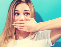 Young woman covering her mouth Royalty Free Stock Image
