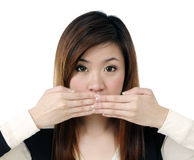 Young woman covering her mouth with both hands Royalty Free Stock Image